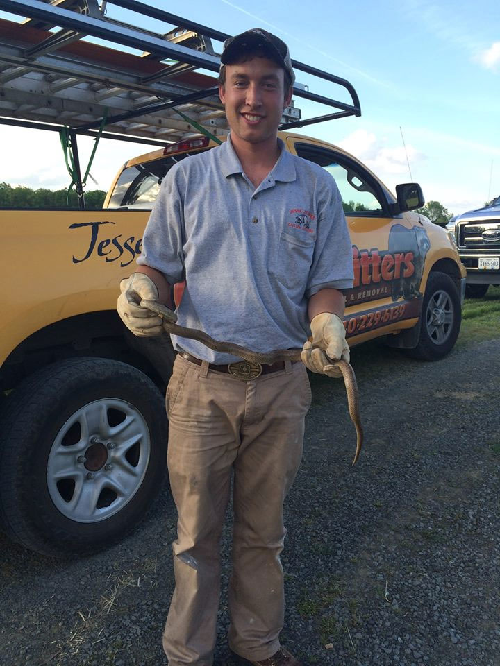 Jesse Outland, owner of Jesse James Critter Gitters, holding one of his critters.